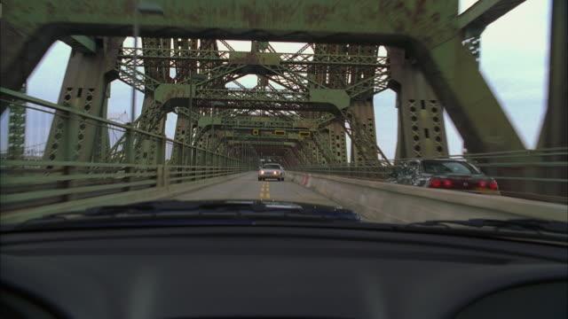 MS POV Car moving against oncoming traffic on bridge
