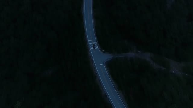 a car moving along a mountain road at night / hwacheon-gun, gangwon-do, south korea - winding road stock videos & royalty-free footage