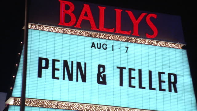 ms pov car moving along las vegas strip towards 'bally's' hotel and casino with sign 'penn and teller' / las vegas, nevada, usa - bally's las vegas stock videos & royalty-free footage