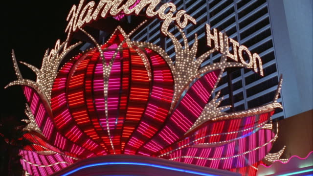 ws pov car moving along las vegas strip towards 'flamingo-hilton' hotel and casino / las vegas, nevada, usa - flamingo hilton stock videos & royalty-free footage