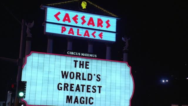 MS POV Car moving along Las Vegas Strip towards 'The Caesar's Palace Hotel' and casino / Las Vegas, Nevada, USA