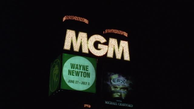 ms pov car moving along las vegas strip towards 'the mgm hotel' and casino with advertisement of 'wayne newton'/ las vegas, nevada, usa - wayne newton stock videos & royalty-free footage