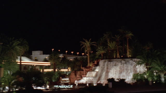 ws pov car moving along las vegas strip towards treasure island and the mirage sign / las vegas, nevada, usa - the mirage las vegas stock videos & royalty-free footage