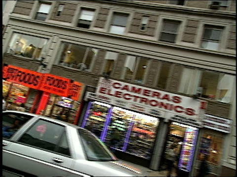 car pov moving north on 8th avenue from 42nd street in new york city in 1994 - anno 1994 video stock e b–roll