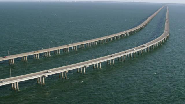 ws ts aerial pov car moving on chesapeake bay bridge / virginia beach, virginia, united states - virginia beach stock videos & royalty-free footage