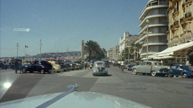 vidéos et rushes de ws car moving on city street beside hotels and building / nice - 1950