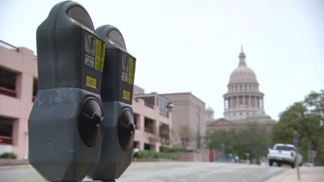 ms car moving on city street with capitol building / austin, texas, united states - texas state capitol building stock videos & royalty-free footage