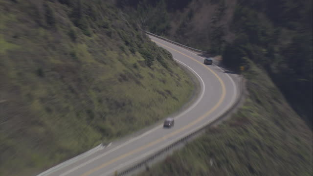WS AERIAL ZI TS ZO Car moving on high way near humbug mountain state park / United States