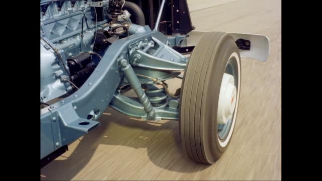 vídeos y material grabado en eventos de stock de ms ts car moving on road / united states - 1960