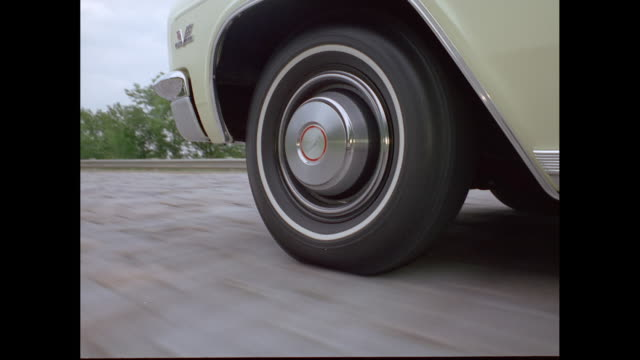cu ts car moving on road / united states - vintage car stock videos and b-roll footage