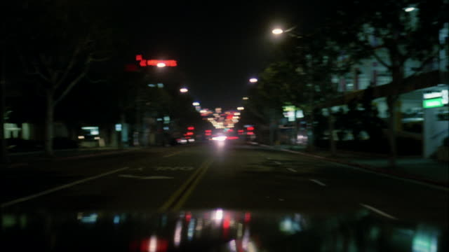 ms pov car moving on street at night / hollywood, california, united states - nightlife stock videos & royalty-free footage