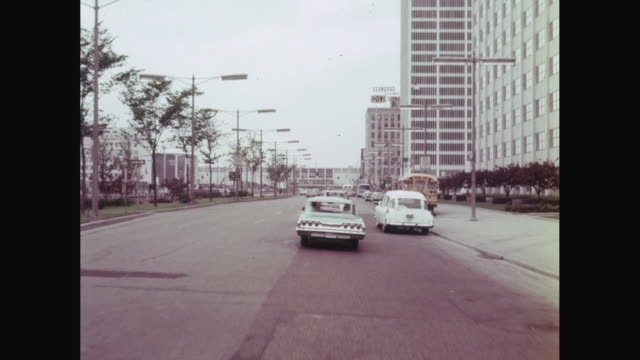 ws car moving on street in detroit / united states - 1964 stock videos and b-roll footage