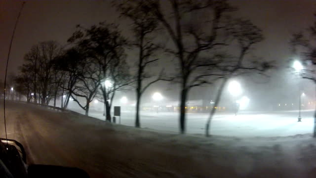 Car POV of night time heavy snow and blizzard conditions in Suffolk County Long Island