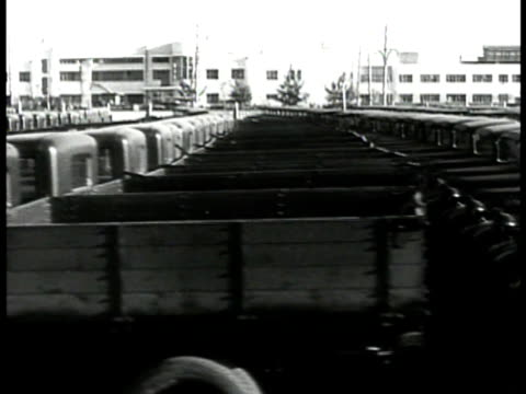 car off factory assembly line joseph stalin picture . lot of empty new trucks. train passing on railroad. freight train. passenger train. int russian... - russia stock videos & royalty-free footage