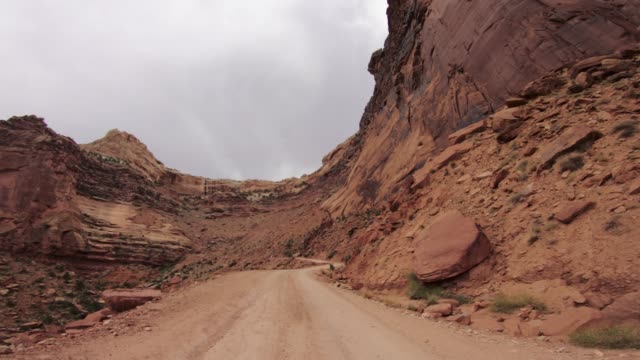 pov car off road driving on shafer trail in canyon, moab - car point of view stock videos & royalty-free footage