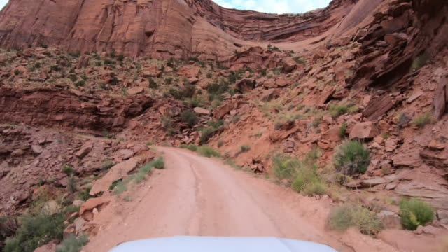 pov car off road driving on shafer trail in canyon, moab - dirt track stock videos & royalty-free footage