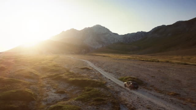 car offroad adventures on the mountain: drone aerial view - sports utility vehicle stock videos & royalty-free footage