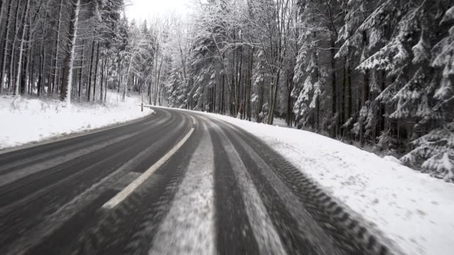 car pov: on an austrian mountain road in winter - rear view mirror stock videos and b-roll footage