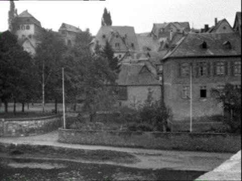 1935 b/w ws pan tu car on bridge crossing river lahn, cathedral in distance / limburg an der lahn, rheinland-pfalz, germany - hesse germany stock videos & royalty-free footage