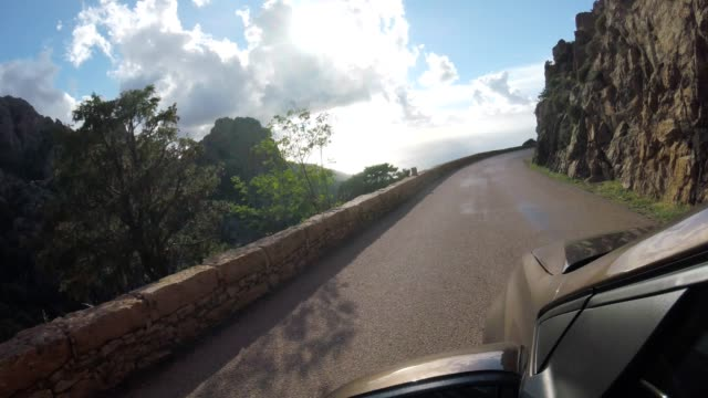 car on corsican country road in summer - coastal road stock videos & royalty-free footage