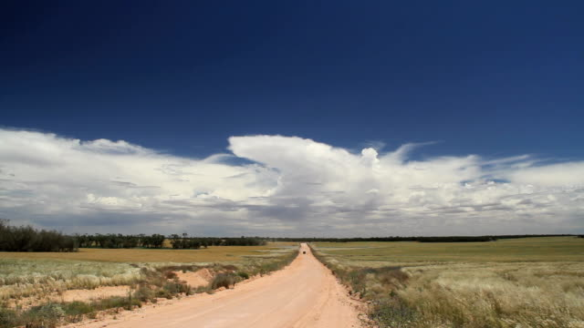 car on dirt road - outback stock videos and b-roll footage