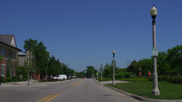WIDE car POV on downtown Lake Forest street, Illinois