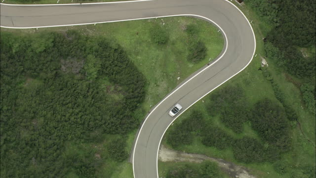 AERIAL ZO Car on hairpins bends, Graubunden, Switzerland