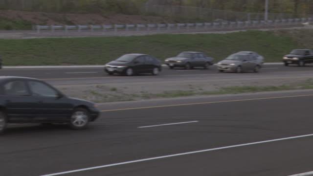 stockvideo's en b-roll-footage met ts car on multi-lane highway skidding sideways to a stop is hit broadside by a car behind it / ontario, canada - verkeersongeluk