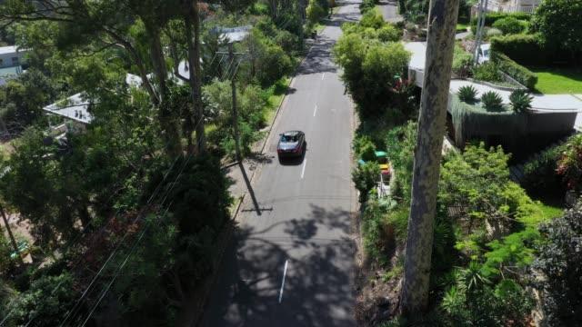 car on road in sydney suburb - 一つ点の映像素材/bロール