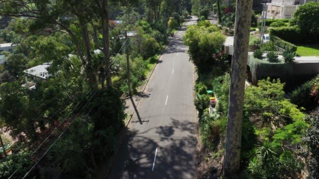 car on road in sydney suburb - treelined stock videos & royalty-free footage