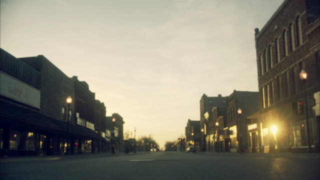 la ws car on small town street in the morning/ pipestone, minnesota - minnesota stock videos & royalty-free footage