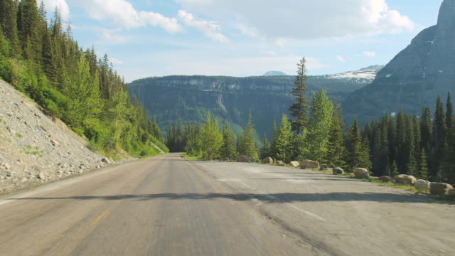 car pov on the going-to-the-sun road in glacier national park. - us glacier national park stock videos and b-roll footage
