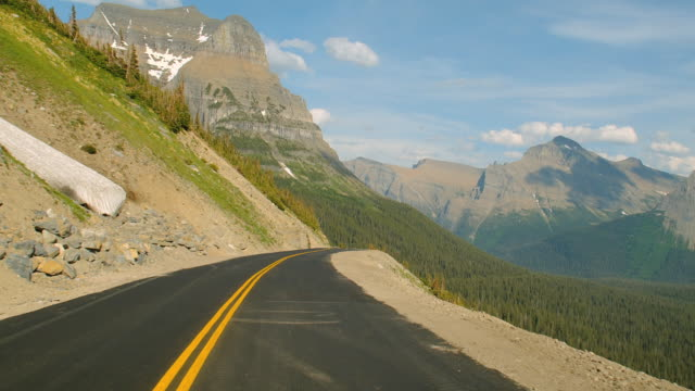 Car POV on the Going-to-the-Sun Road in Glacier National Park.