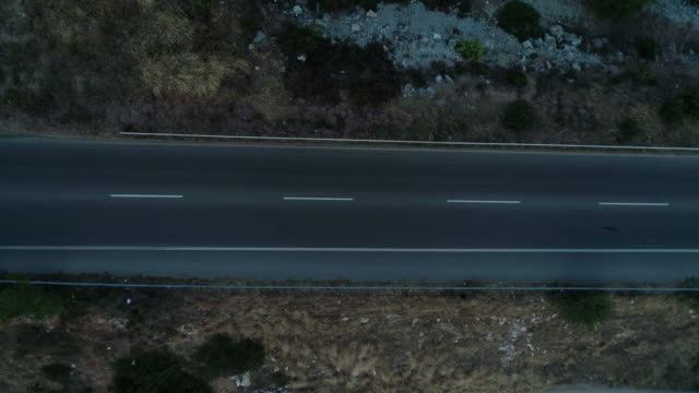 car on the road from drone view - empty road stock videos & royalty-free footage