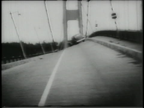 b/w 1940 car on twisting tacomanarrows bridge / washington - suspension bridge stock videos & royalty-free footage