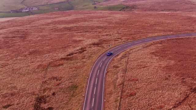 car on winding country road between oxenhope and hebden bridge, england - drone shot - pennines stock videos & royalty-free footage
