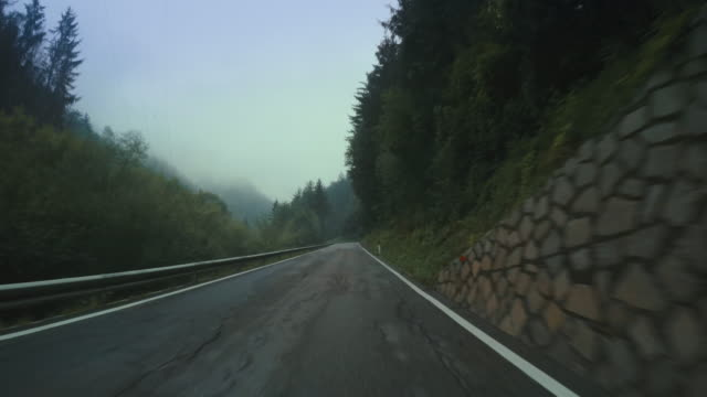 car onboard camera on a foggy mountain pass - car point of view stock videos & royalty-free footage