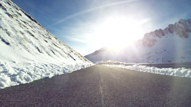 car onboard camera on a winter mountain pass - road sign stock videos & royalty-free footage