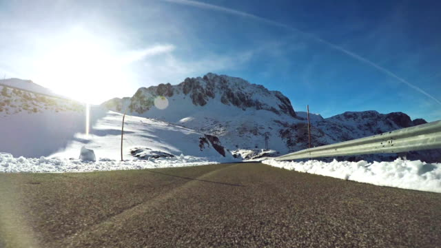 car onboard camera on mountain pass with snow - european alps stock videos & royalty-free footage
