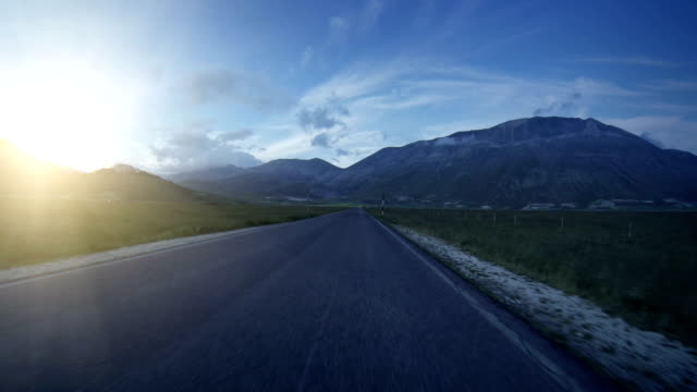 Car Onboard Camera on Straight Road at dawn