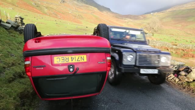 car overturned on kirkstone pass above ambleside in the lake district, cumbria, uk. - mountain range stock videos & royalty-free footage