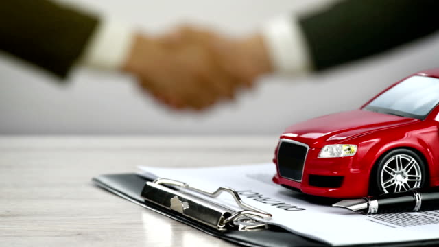 car ownership - car rental - car contract - handshake - 4k resolution - moving image stock videos & royalty-free footage