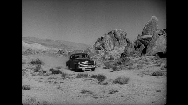 1953 a car parks in the desert - film noir style stock videos & royalty-free footage