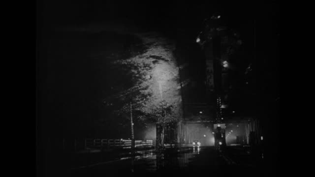 1948 a car parks on a deserted bridge at night - film noir style stock videos and b-roll footage