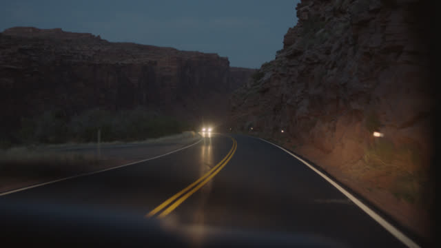 car passenger pov riding through rocky utah canyon by the colorado river at dusk. - colorado stock videos and b-roll footage
