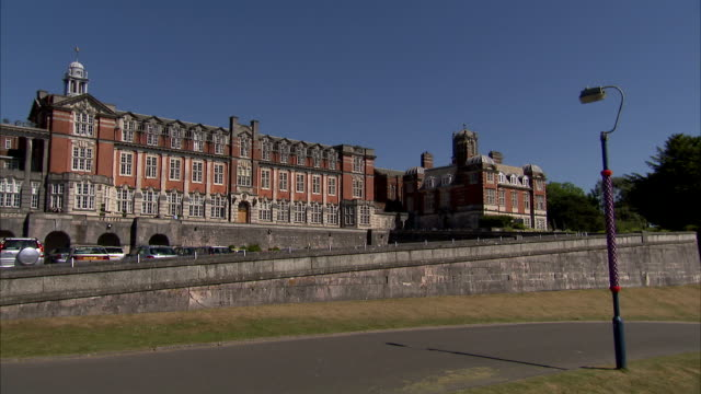 A car passes a building on the campus of Britannia Royal Naval College. Available in HD.