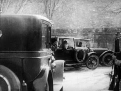 car passes soldiers with guns standing at attention + pulls up behind others / san fran - anno 1927 video stock e b–roll