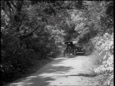 B/W 1938 car passing horse + buggy on country road