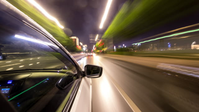 car passing through city traffic, time-lapse photography - headlight stock videos & royalty-free footage