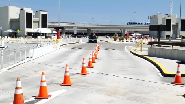 car passing through marked area at san francisco international airport, in san francisco, california, u.s., on monday, may 4, 2020. lyft... - san francisco international airport stock videos & royalty-free footage